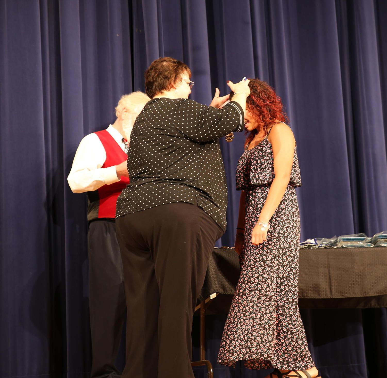 Senior+Alanna+MacAdam+receives+her+medal+from+principal+Cynthia+Prieto+at+the+Excellence+Awards.+