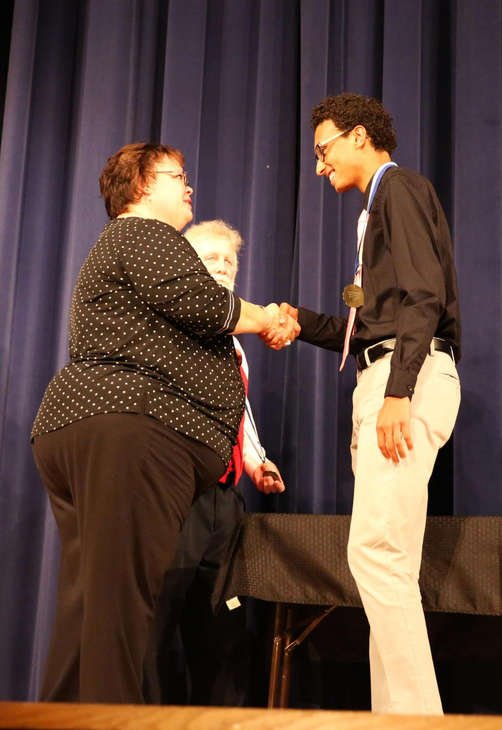Senior+Isaiah+King+shakes+hands+with+principal+Cynthia+Prieto+after+receiving+his+medal.+King+received+an+%22Outstanding%22+distinction%2C+as+he+was+recognized+by+teachers+from+four+separate+departments%2C+one+of+three+students+to+do+so.+