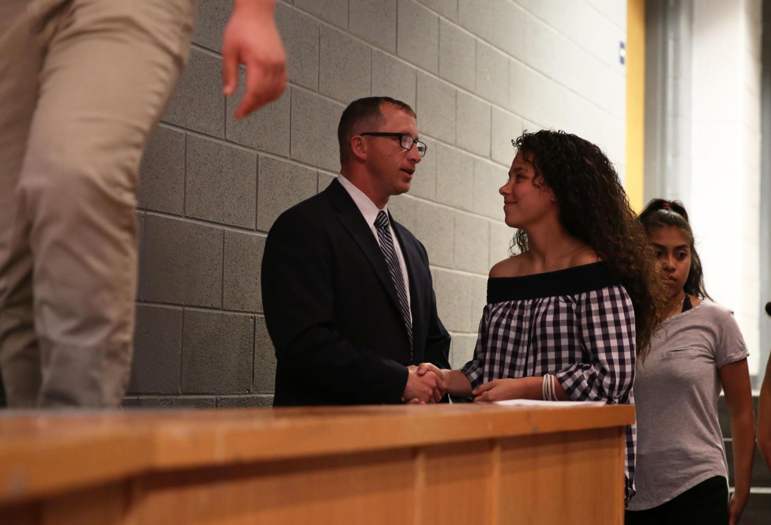 Sophomore+Francheska+Fontanez-Gonzalez+shakes+hands+with+assistant+principal+Eric+Miller+prior+to+heading+on+the+stage+to+receive+her+award.+