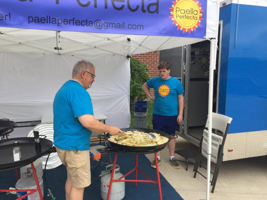The McIntires serve paella during the event.