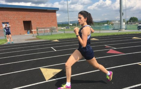 Sophomore Ana Rodriguez competes in the 4x800m relay at the regional track meet. Rodriguez is also an exchange student from Spain.