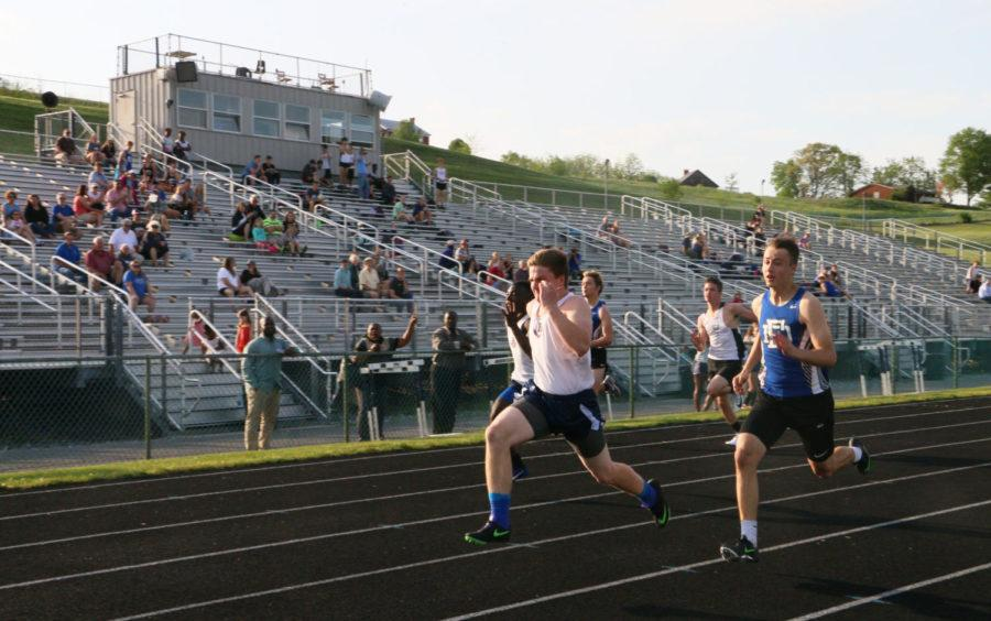 Freshman Conor Wells takes the lead in the boys 100 meter dash at an outdoor track meet in 2018.