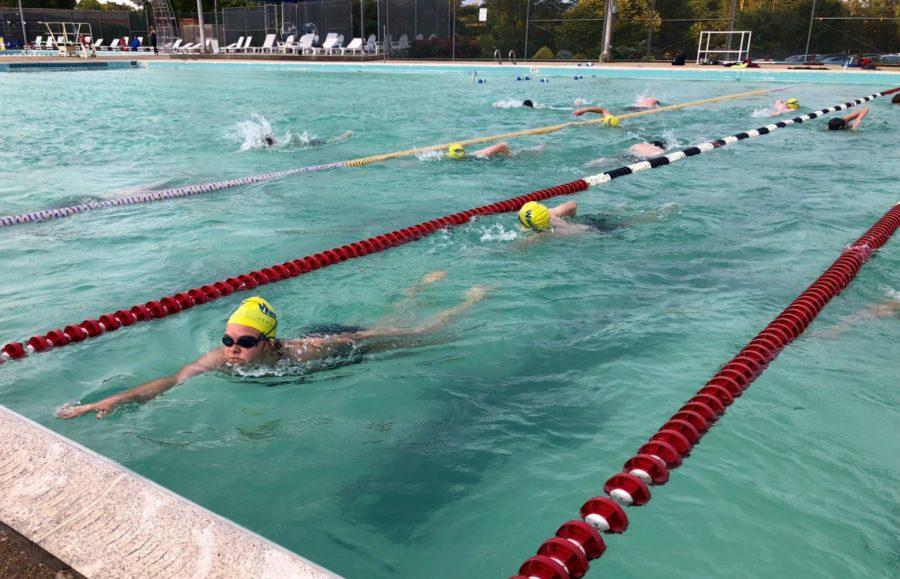 Freshman Eva Velker glides in to her turn during  a workout at the Westover Waves swim practice.