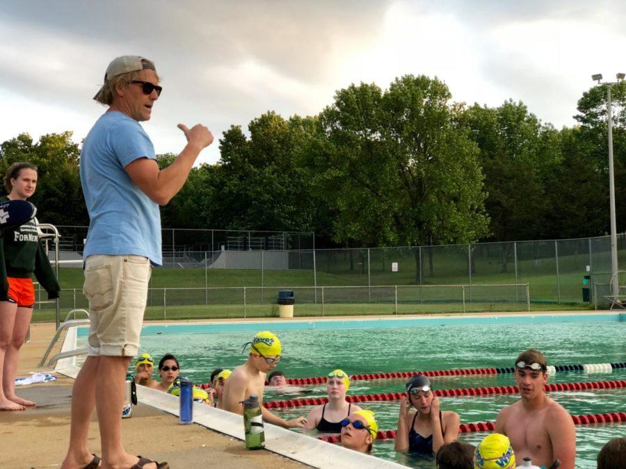 Westover Waves head coach Chad Gusler explains the workout to the swimmers at practice.