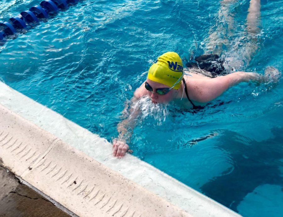 HHS JV swimmer Desirae Sandridge finishes at the wall after completing the set during practice.