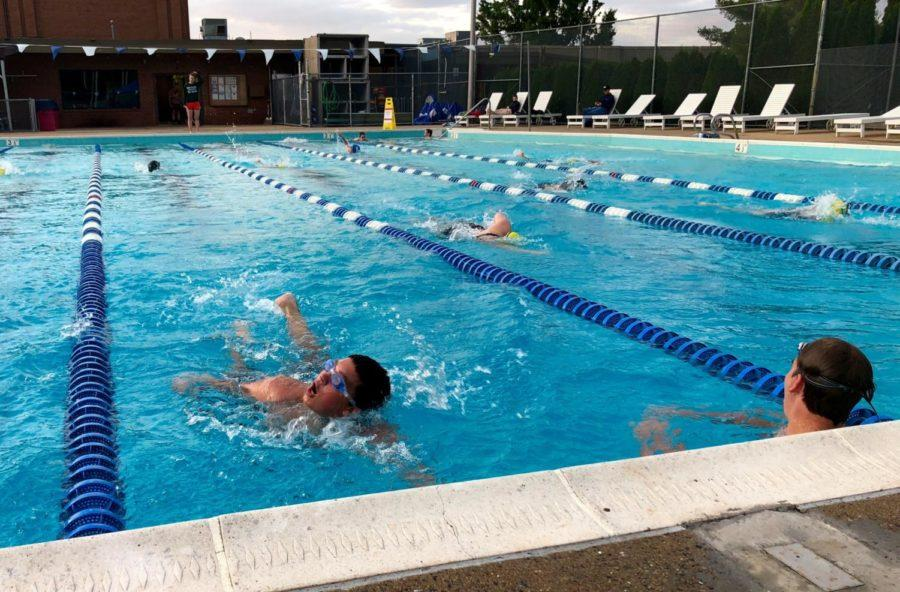 Freshman Jakob Lambert swims to the wall during a breathing exercise in the workout.