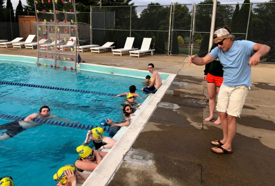 Head coach Chad Gusler demonstrates incorrect technique during the Westover Waves swim practice.