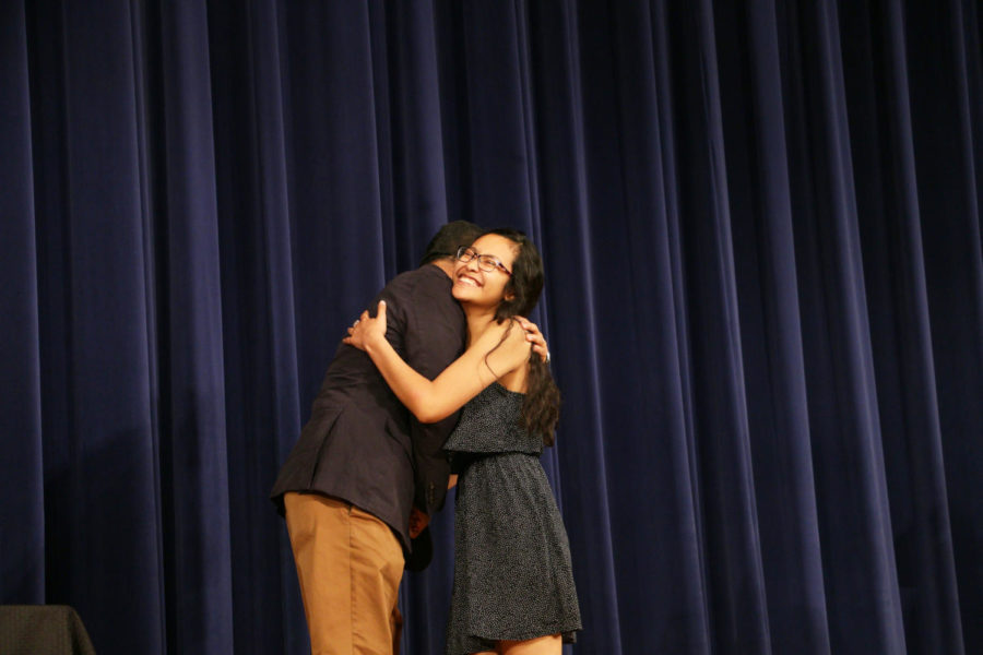 Senior Helen Joya embraces her mentor on stage, as she gets presented with the Scholars Latino Initiative Scholarship. Joya will attend UVA this fall.