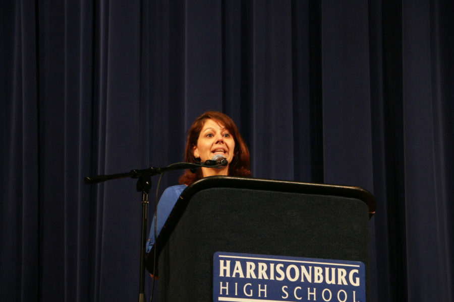 Guidance counselor Danielle Brino speaks on behalf of the ECMC Scholarship.