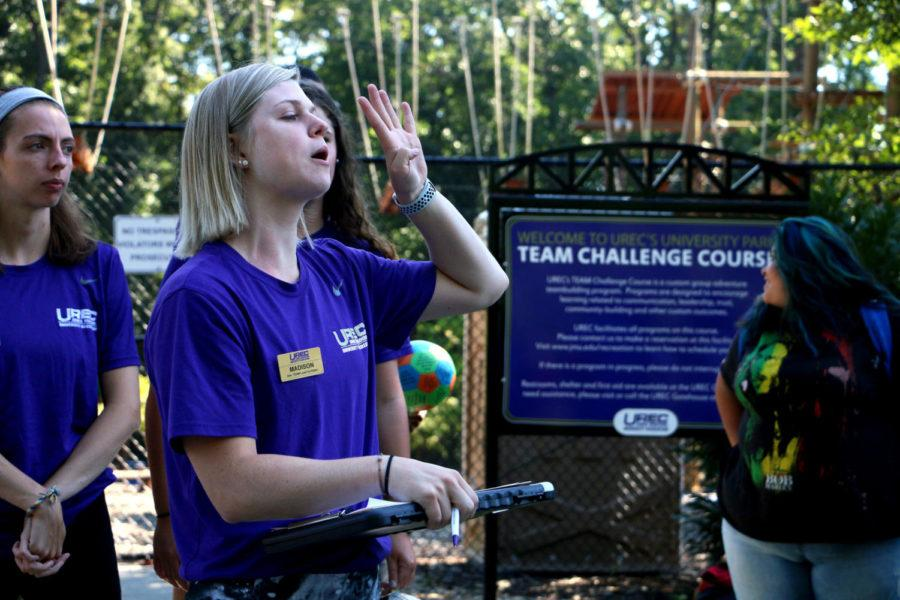 Madison White, a rising senior at JMU, yells for students to get into groups of four for an activity. White led the Summit Academy through multiple exercises during her first day as a Foundational Teamwork Leader.