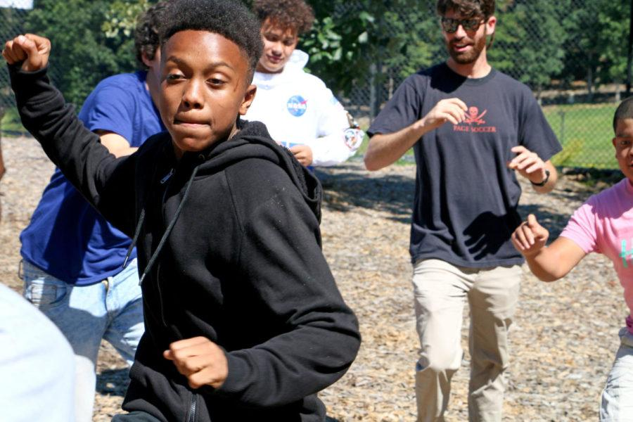 Sophomore Emmanuel Trammell prepares to defend himself in a game of trainwreck. Groups were placed in a circle and had to run to the middle before finding a new spot on the outside. After four turns in the middle, Trammell had to struggle to make it out of the middle.