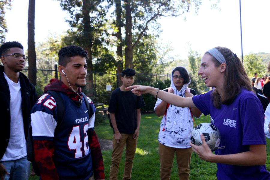 A JMU Team Challenge Course employee explains the first team building activity of the day, celebrity bodyguard. One student was responsible for protecting another from the paparazzi.
