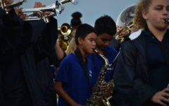 Eighth Grade band plays along with the Friday night band