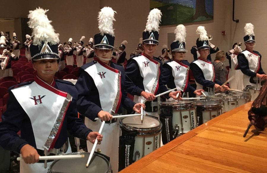 The+drumline+warms+up+with+the+band+before+performing+the+stand-still+show+at+Stuarts+Draft+High+School.+