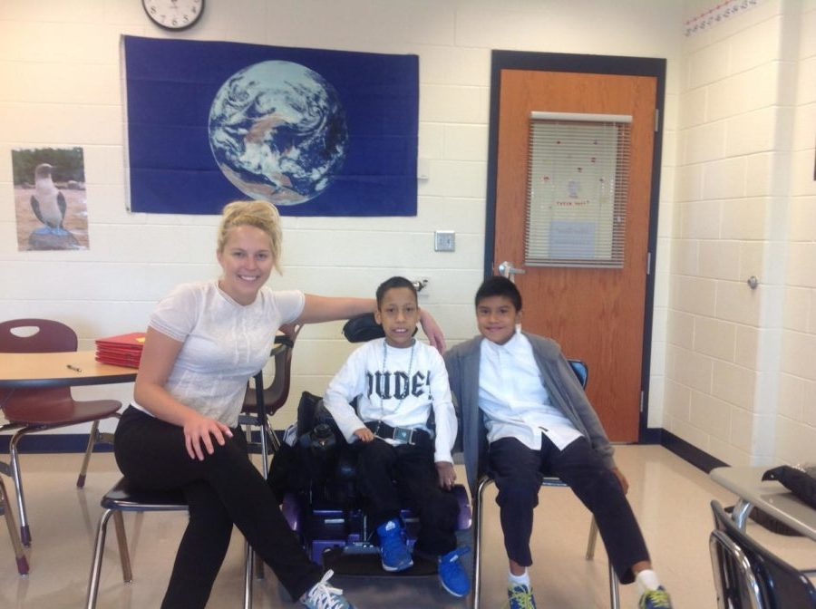 Special education teacher Kelsey Bass works with previous Skyline Middle Schoolers Alan Garcia Ruiz  and John Lopez. Ruiz and Lopez are current freshmen at the high school this year.