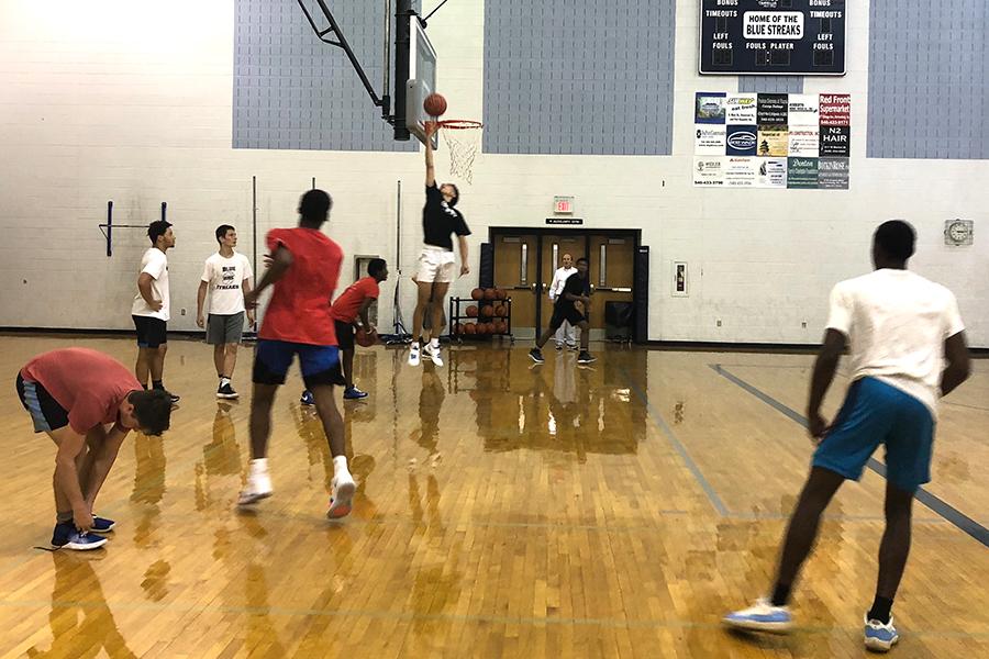 Boys basketball players participate in preseason practice.