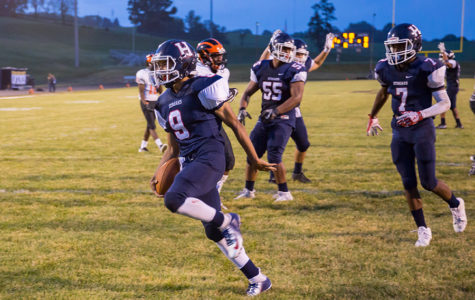 Junior quarterback Kwentin Smiley celebrates after a touchdown. Smiley had 362 total yards and five touchdowns.