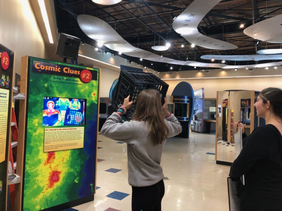 The Green Bank Exhibit Hall features an infrared camera, where different objects can be used to observe how infrared waves move through different materials.