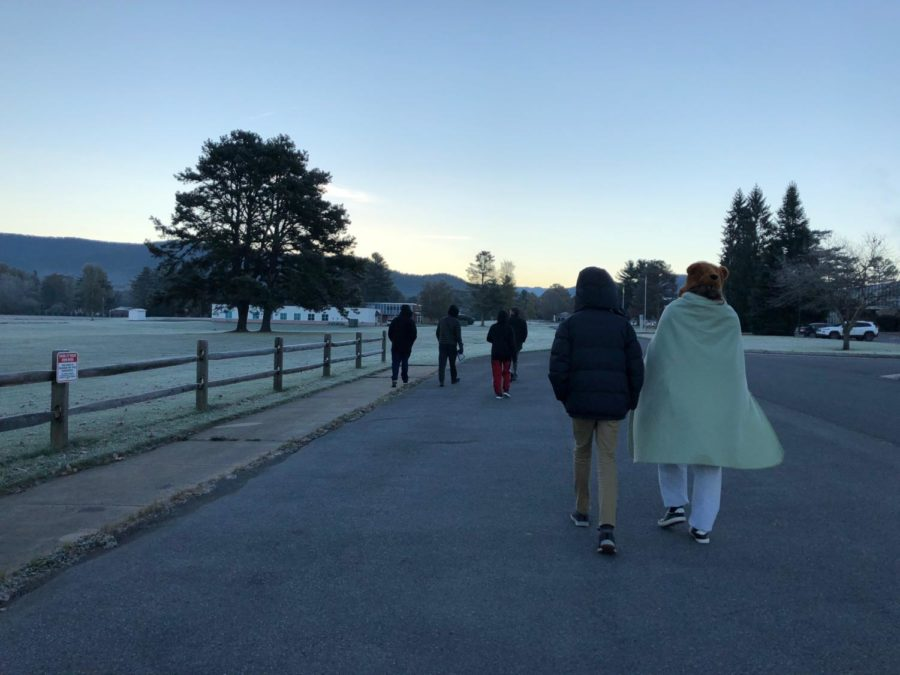 A group of students walk back to the bunkhouse at 7:30 A.M. after using the 40-foot telescope to make observations.
