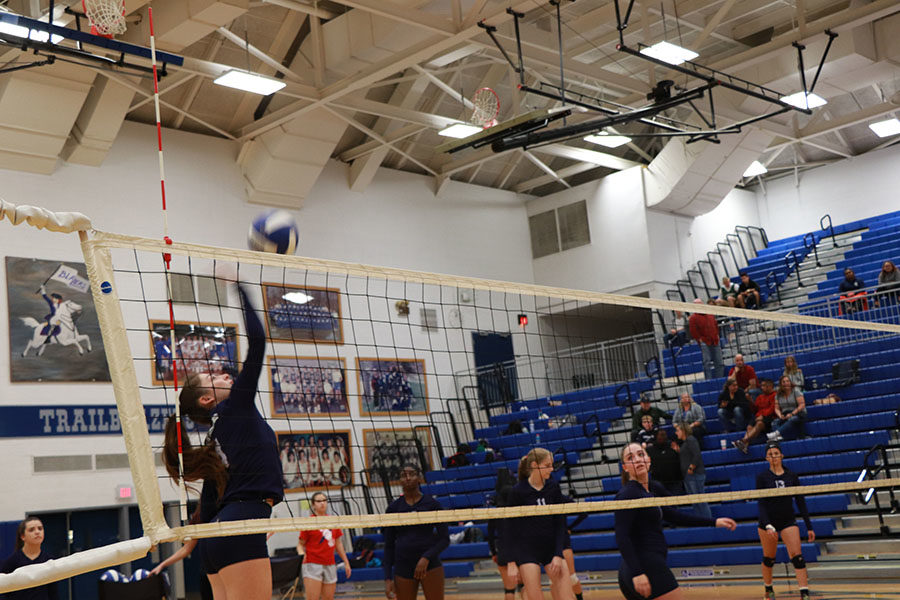 Junior Abby McCollum  tips the ball during warmups.