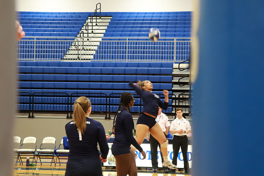 Junior Jakaya Brandon a outside hitter, warms up her arm before the game.
