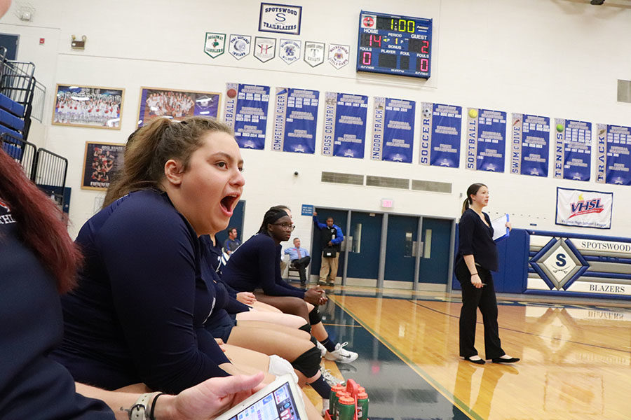 Junior Paula Moreira cheers on teammates during the second set against the Blazers.
