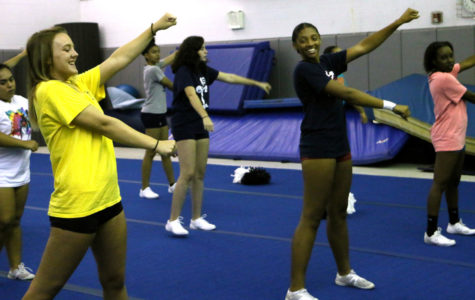 Cheer team practices before Friday game