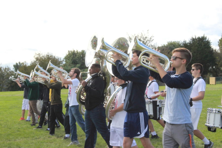 The low brass section practices their forward marching.