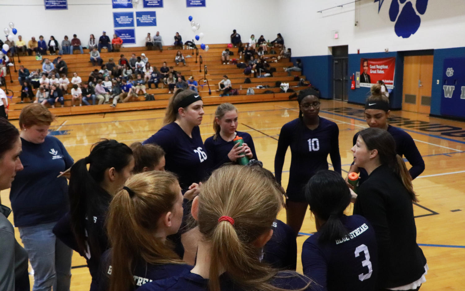 Coach+Hannah+Bowman+discusses+strategy+during+a+timeout+in+the+first+set.+