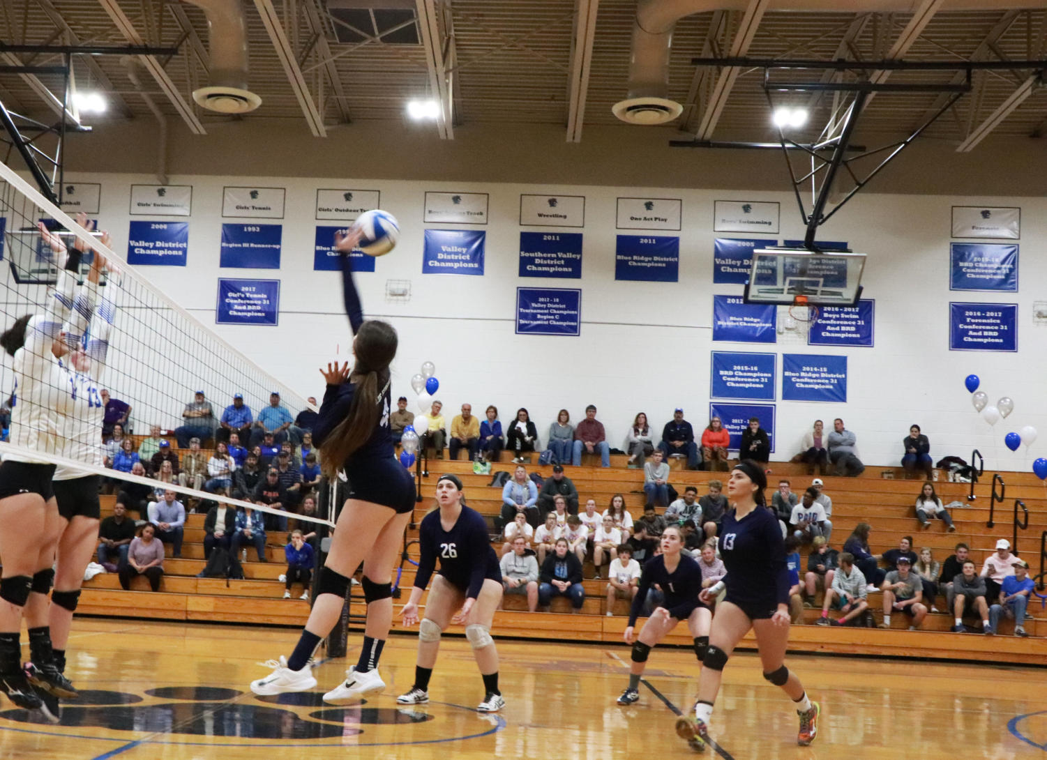 Junior+Abby+McCollum+goes+up+to+hit+in+the+first+set+against+the+Rockbridge+Wildcats.+