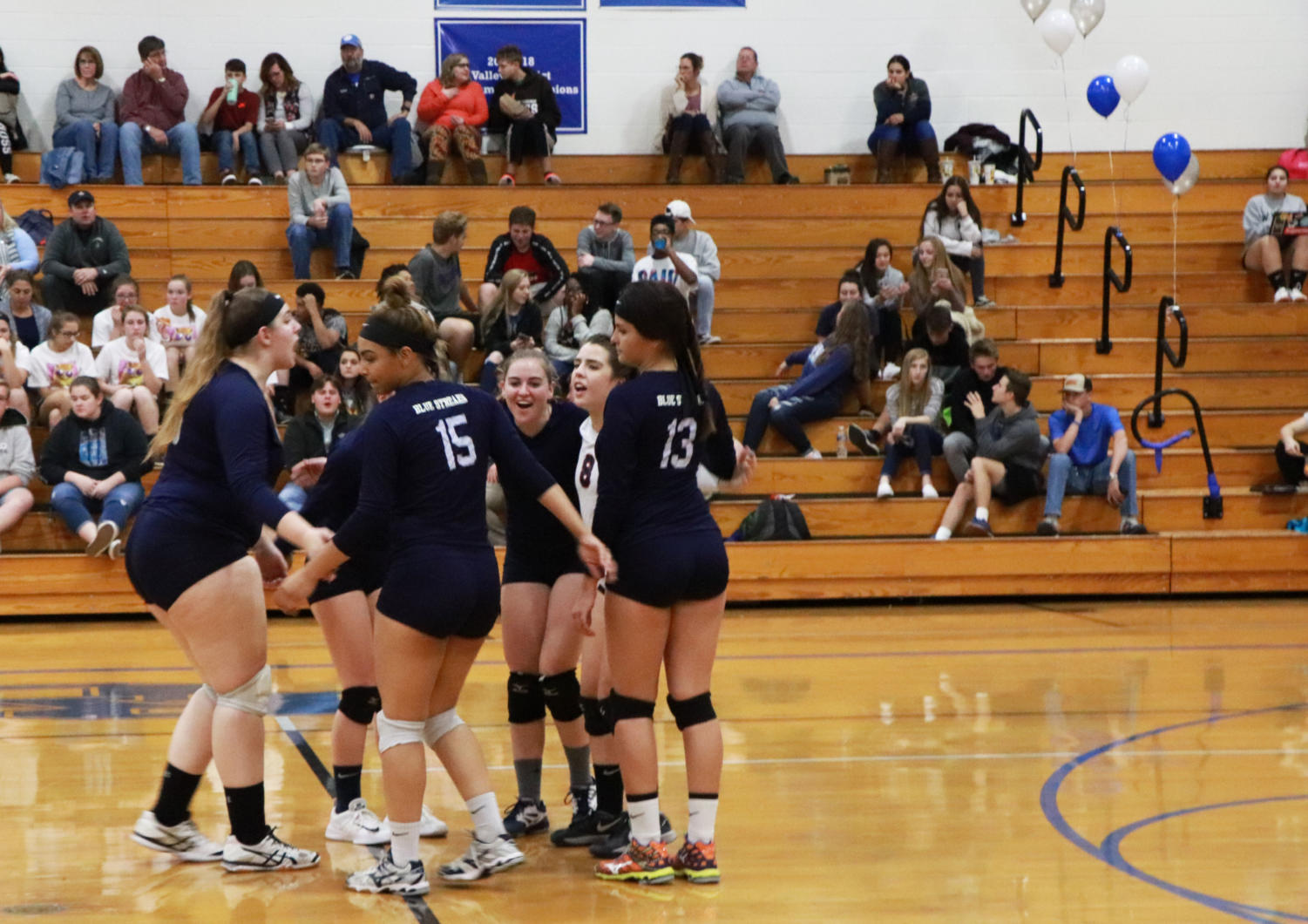 The+Streaks+celebrate+a+kill+in+the+first+set.+The+Wildcats+took+the+first+set+25-13.+