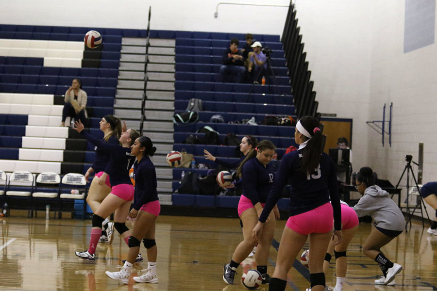 The+HHS+Varsity+Volleyball+team+warms+up+before+their+match+against+Rockbridge.