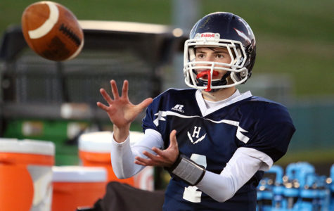 Freshman Keenan Glago warms up on the sideline. The Streaks beat Fort 24-6.