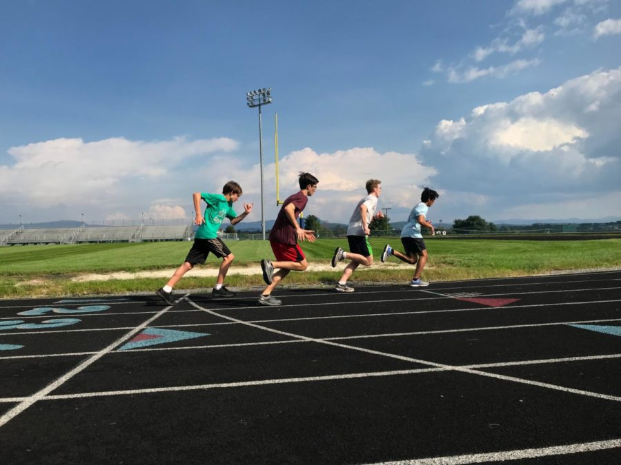 Owen Johnston and his teammates run the 400 meter during practice.