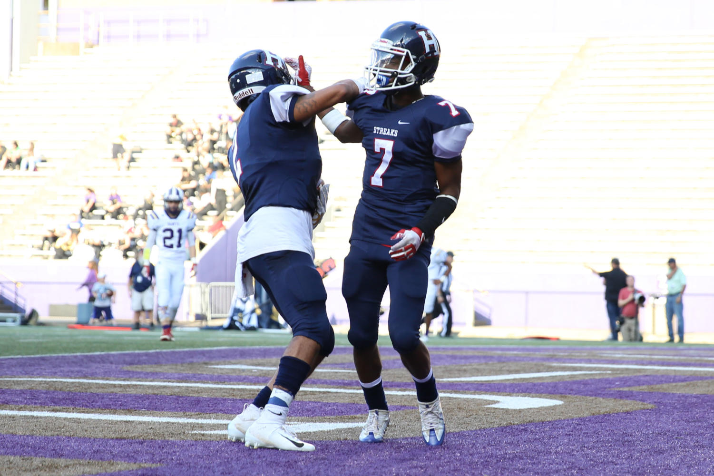 Junior Jahiem Anderson and senior Marcus Robinson-Jenkins celebrate a touchdown.