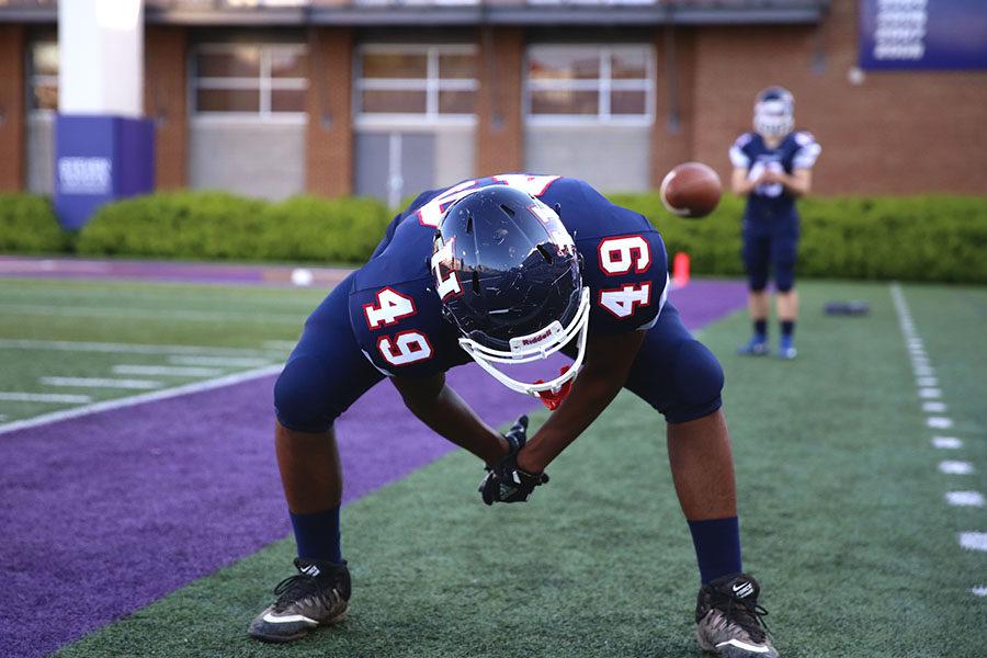 Junior Jaydon Jackson works on his long snaps on the sidelines.