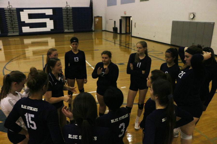 Coach Hannah Bowman-Hrasky discusses strategy in the third set. The Streaks fell short 13-25 at the end of the set.