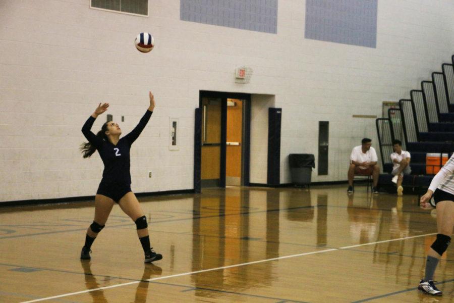 Senior Sarah Earle serves the ball in the third set.