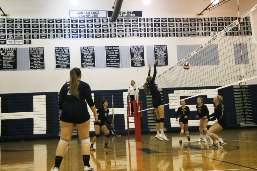 Sophomore Amelia Mitchell goes up to block.