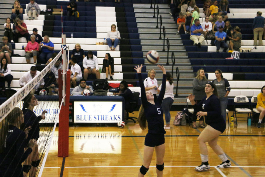Junior setter Whitney Purcell sets the ball to Staton while the Streaks warm up before the game. Purcell assisted 25 kills and scooped up eight digs over the course of the match.