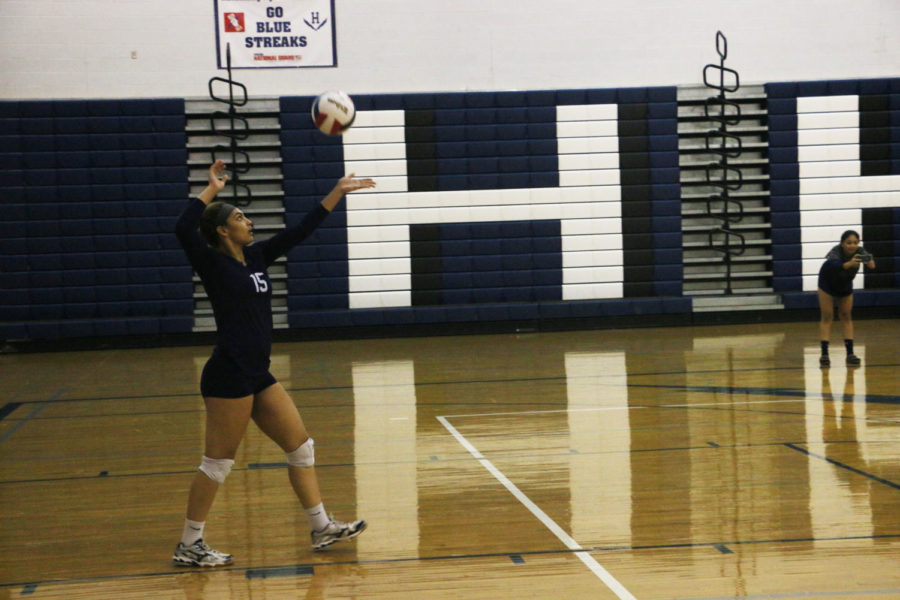 Junior Jakaya Brandon serves the ball. Brandon finished the match with nine kills, eight digs and two aces.