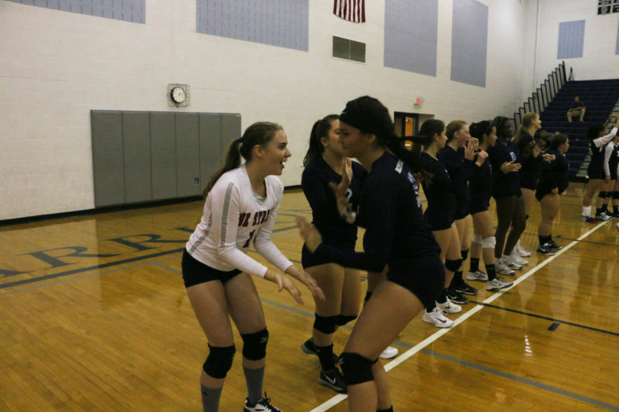 Seniors Melany Nazario and Andrea Osinkosky high five before the game against Rappahannock County on Monday.