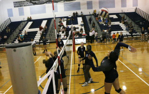 Nazario goes up to hit the ball prior to the game. Nazario finished the match with eight kills and a block.
