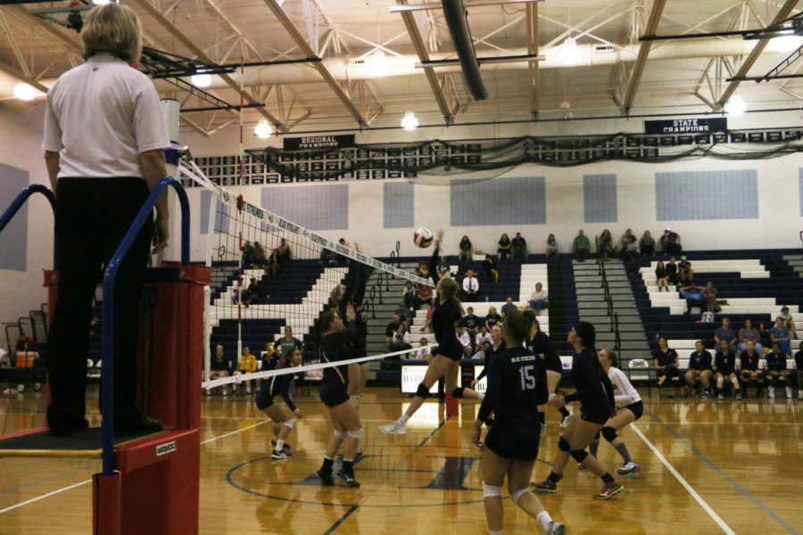 Sophomore Amelia Mitchell hits the ball over the net in the fourth set. The Streaks took the set 26-24 to win the game 3-1.