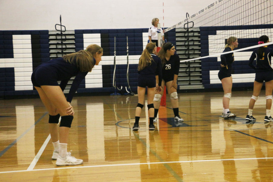 (From left) Amelia Mitchell, Whitney Purcell and Becky Staton look on as they wait for the ball to be served.