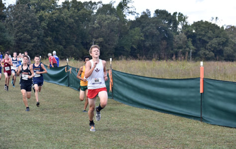 Junior Tucker McGrath runs to the finish of the Varsity B boys race at the Milestat invitational.