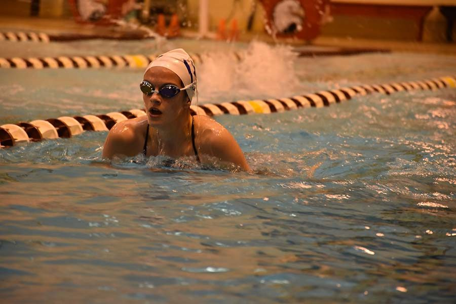 Isabel Campillo swims breaststroke during warm up.
