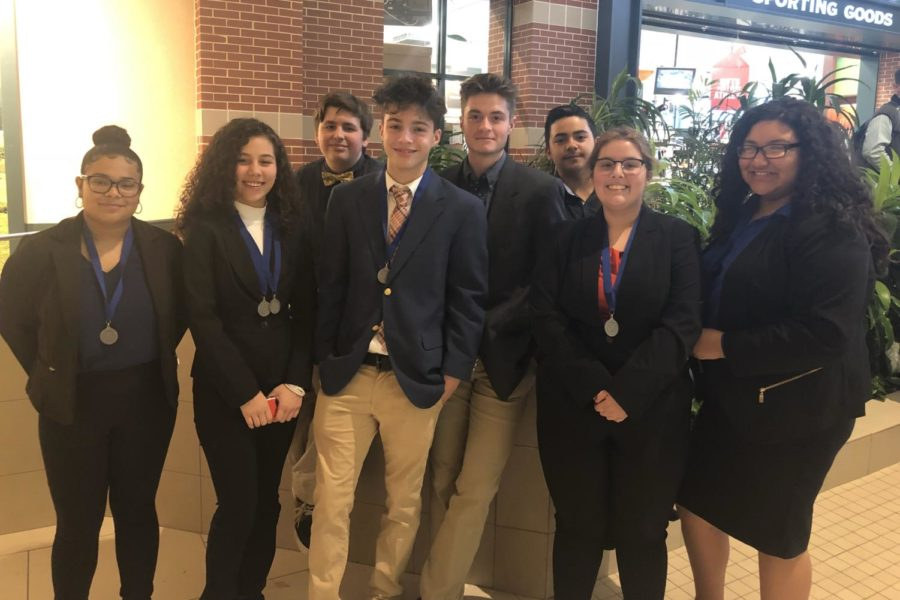 DECA members take a group picture after competing in Districts.