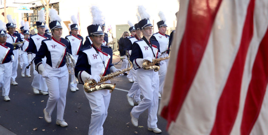 Harrisonburg marching band and JROTC march downtown for