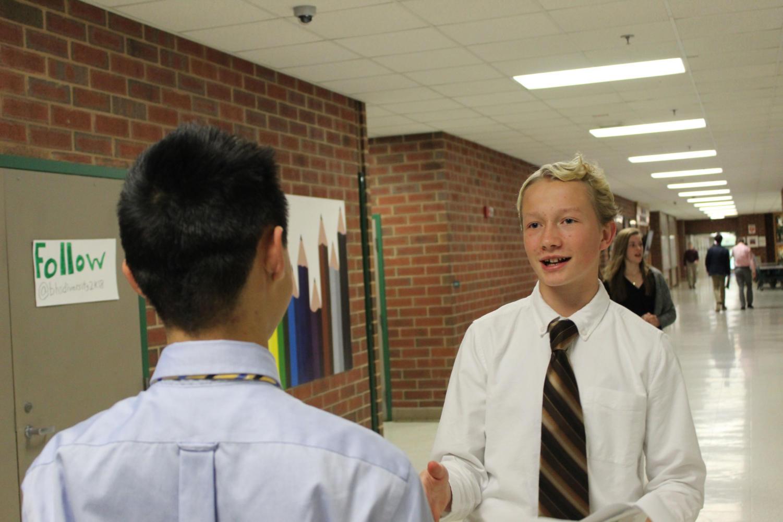 Freshman Micah Tongen prepares for his debate round.